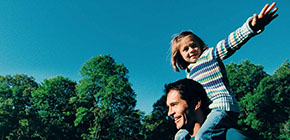 Child on Dad's shoulders shows one example of how Standard Life uses data analytics to market to specific audiences.