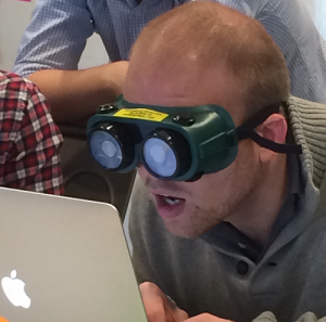 An IBM Designer uses low vision goggles during designer training to help develop empathy for the vision impaired.