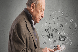 Picture of elderly man looking down at a mobile device