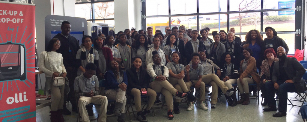 Approximately 50 students from Carver Vocational-Technical High pose for a picture inside the Local Motors facility.