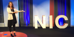 IBM's Susann Keohand stands on the NIC Talks stage.