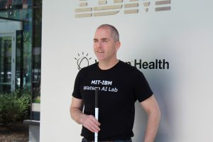 Picture of Erich Manser in front of IBM Watson Health Sign