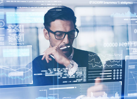 Business person reading analytics on screen