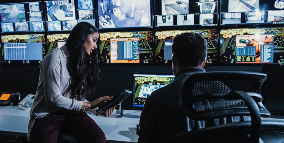 Security guards watching monitors in control room