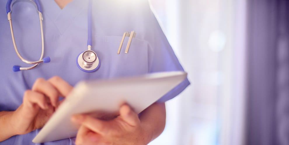 healthcare worker using tablet