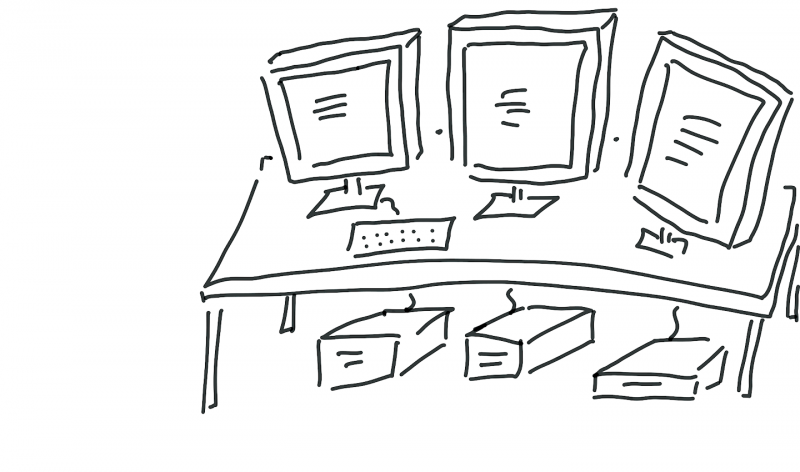 A desk with many computers on it