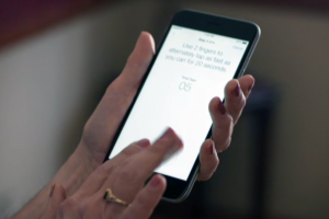 A Parkinson's patient performs a series of tests using ResearchKit. (Source: Apple)