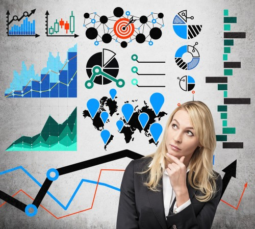 businesswoman thinking with drawing analytics concept on wall
