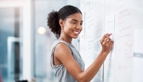 African American woman at whiteboard