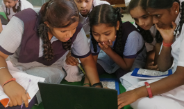 Indian female students studying at a laptop