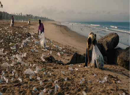 A community collects plastic from a beach