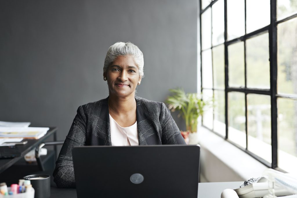 Woman working in a hybrid office