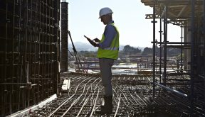 Architect using tablet computer on building site