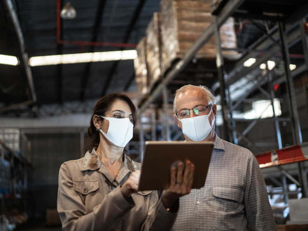 Retail warehouse workers using a tablet