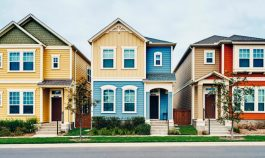 three colorful houses in a row
