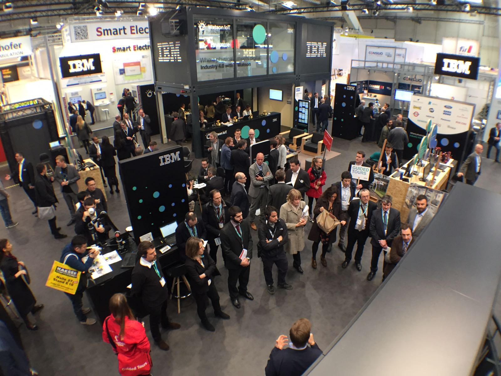 An aerial view of visitors to the Digital Twin demonstration at IBM's Hannover Messe booth