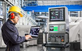 Engineer using computer for maintenance equipment in thermal power plant factory