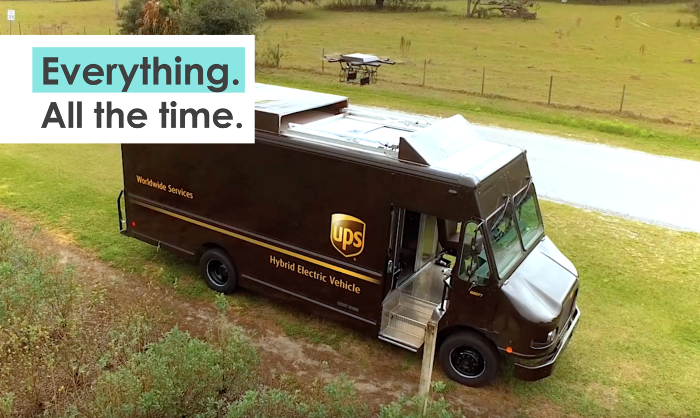 A UPS driver delivers a parcel with autonomous vehicles with drones