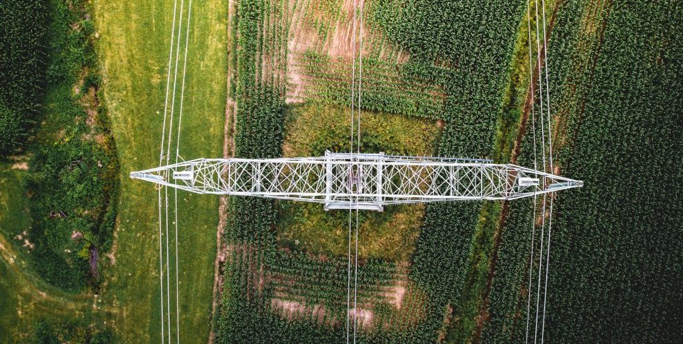 Aerial view of electrical wires large scale power energy tower
