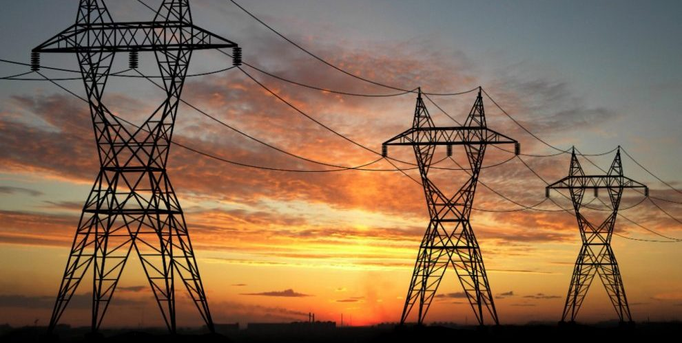 Electric powerlines over sunrise