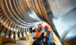 Workers inspect turbine in power station