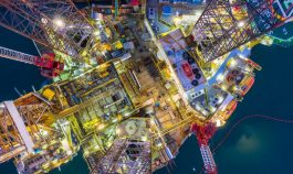 Aerial view offshore oil and gas rig drilling platform at night,