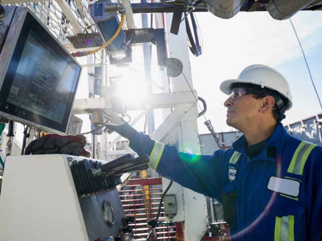 engineer operating drilling rig at gas plant