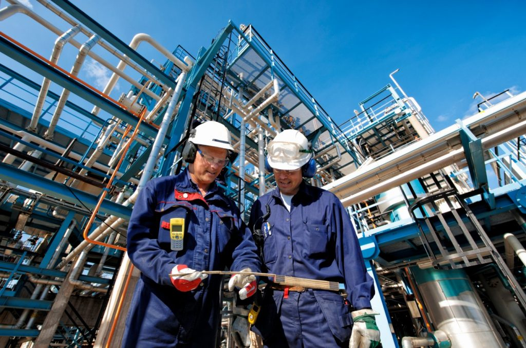 Two oil and gas workers at refiner