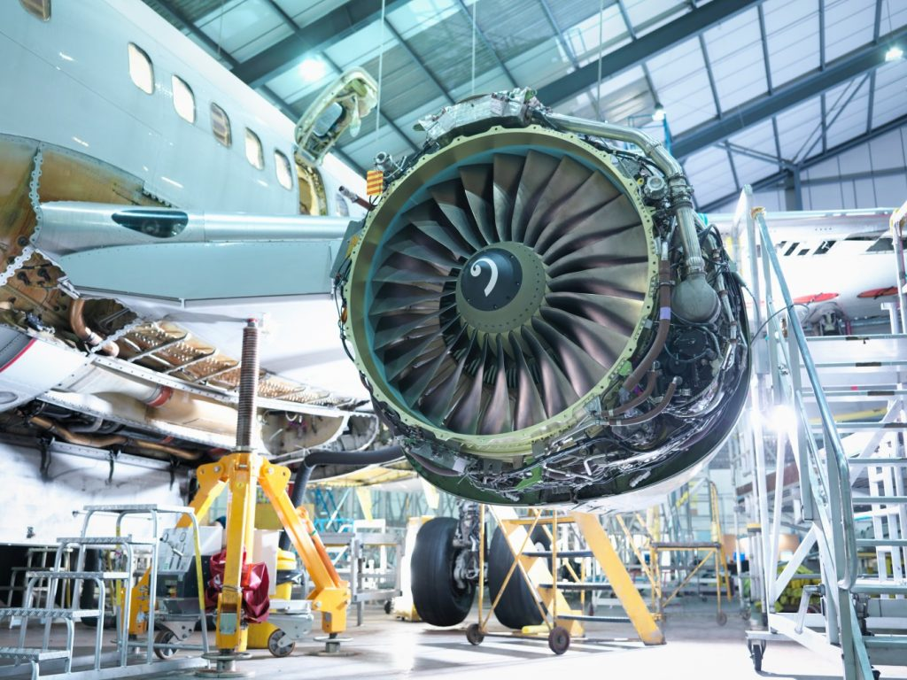 Airplane engine in a hanger for maintenance