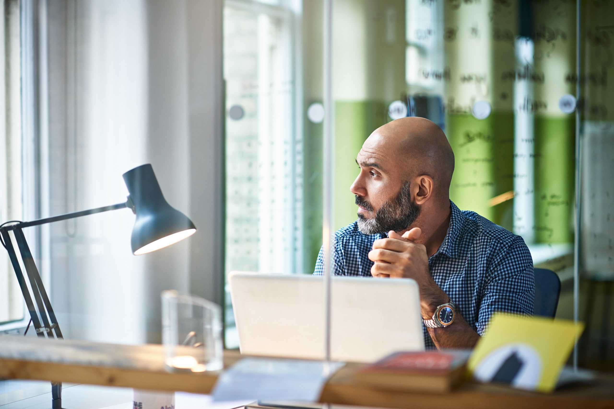 man sitting in office with laptop