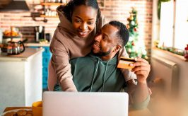 Couple sitting in front of computer