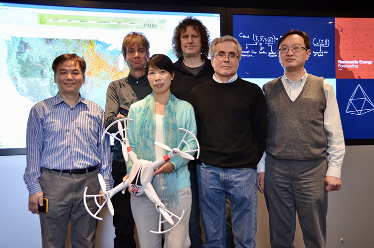 Group photo of IBM Research team building the world's first platform for collecting, curating and searching global data by space and time. From left to right: Rong Chang, Hendrik Hamman, Xiaoyan Shao, Marcus Freitag, Ildar Khabibrakhmanov, Siyuan Lu
