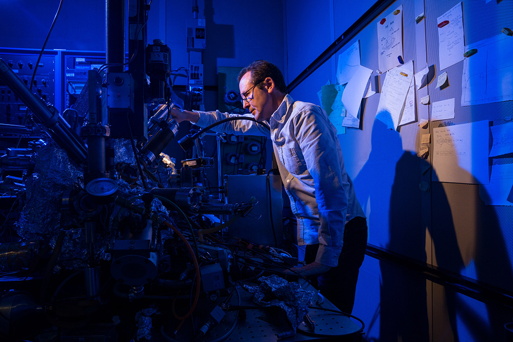 Co-author Dr. Christopher Lutz of IBM Research - Almaden in San Jose, Calif. stands with IBM's Nobel-prize winning microscope used to achieve the first single-atom qubit. (Stan Olszewski for IBM)