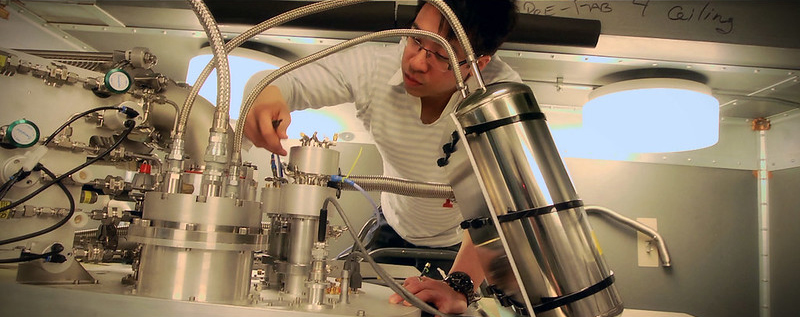 In 2012, Dr. Jerry Chow prepares the dilution refrigerator for a quantum experiment. The dilution refrigerator gets down to 15 to 20 millikelvin in order to keep the quantum states very pure and to get the quantum bits into their ground states before any experiments are done. By being this cold, the qubits are less susceptible to any sort of thermal noise and thermal heating that would otherwise bring the qubits out of the ground state. (Credit: IBM)