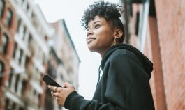 woman in urban environment with phone