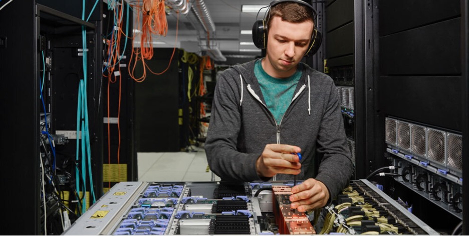 person doing work at an IBM server warehouse