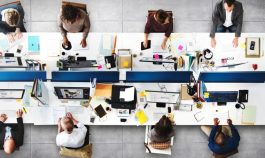 picture from above of a group of people working on a desk