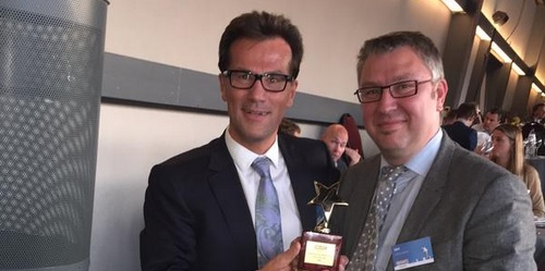 IBM's Bart Windal and Cedric Mulier, proudly accepting the Smart Business Award for Analytics and Business Intelligence