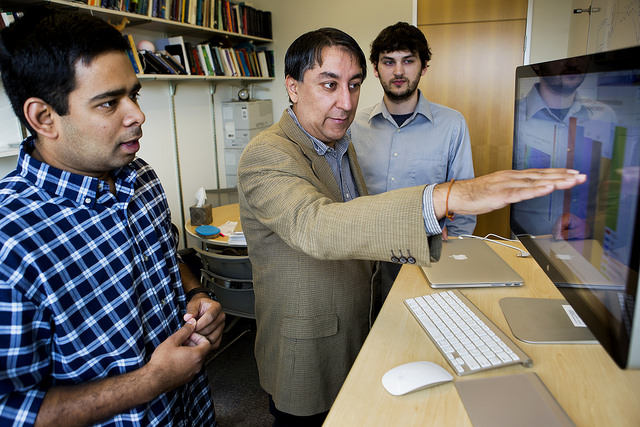 Satinder Singh Baveja, director of the Artificial Intelligence Lab, with students.