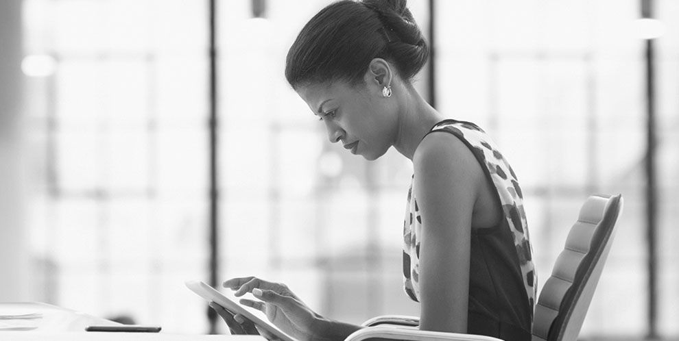 Business woman looking at tablet