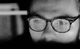A developer is staring at their screen as they work on setting up FHIR technology for their healthcare organization.