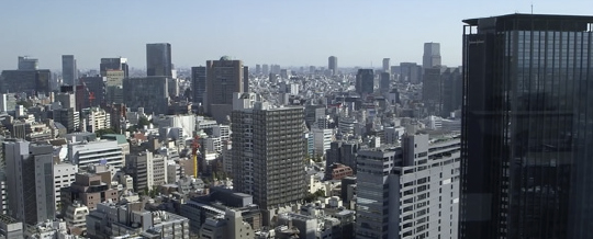 Japanese cityscape image representing case study of KDDI telecom firm using IBM Cloud Object Storage to store consumer digital files