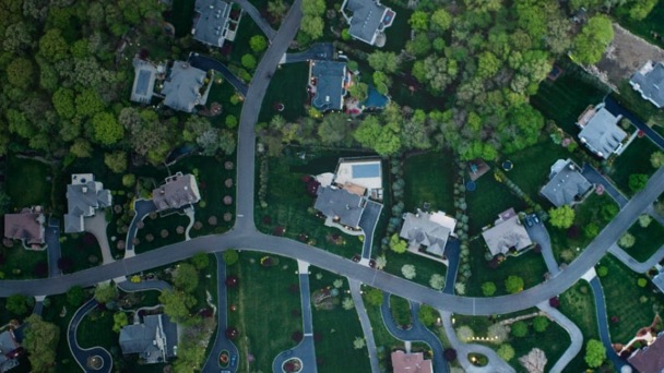 Overhead view of a shady lane in a neighborhood