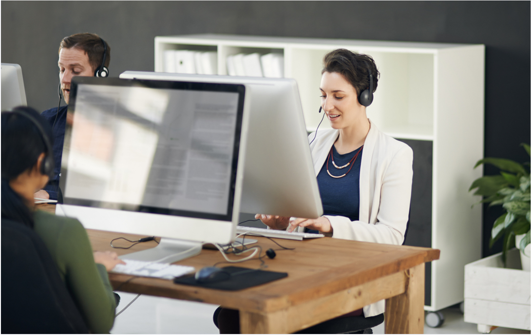 People using computer while wearing headset