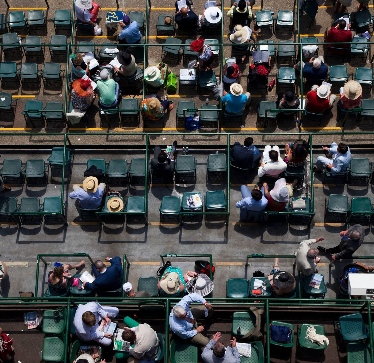 Overhead shot of people sitting in chairs at a derby.