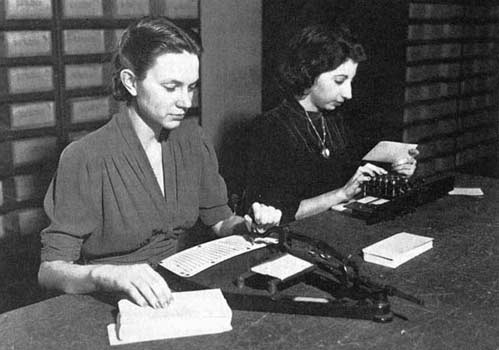 Woman working at a punched card station