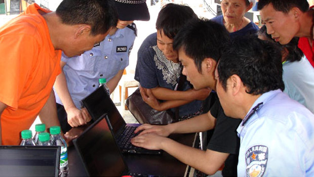 People in Chengdu, China gather around a Sahana management system