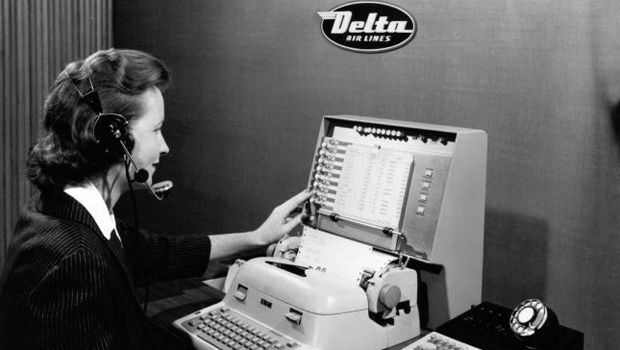 Delta Airlines employee taking a reservation at a SABRE system