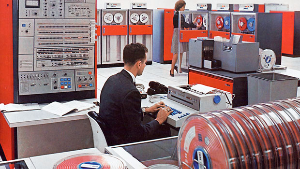 IBM System/360 red color w/ man and woman in computer lab setting circa 1960's
