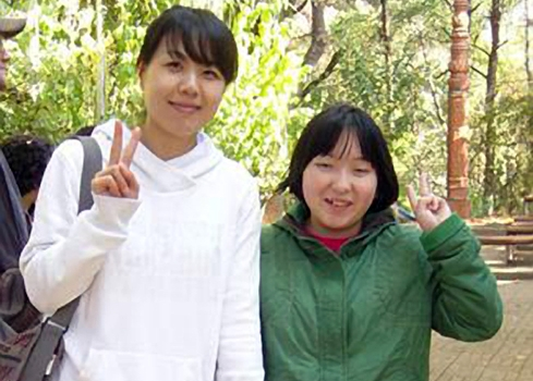 "HyungHwa (left) has been a ""face-to-face"" volunteer since 2003."